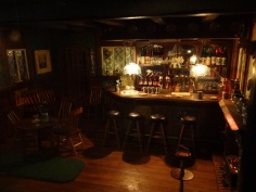 This was one of the sets at The Miniatures Museum of Taiwan. My finger is about as long as one of those barstools.