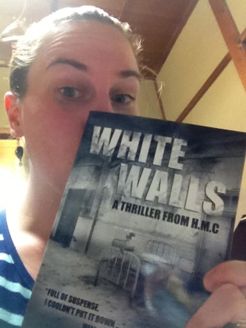 """In 2013, I started reading books by people I actually KNOW. This was pretty cool for me! Here I am holding a signed copy of """"White Walls"""", by H.M.C."""