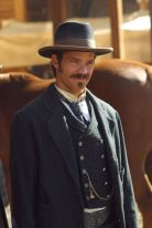 Seth Bullock, of Deadwood, just wants to do right by the world and his fellow man. He marries his dead brother's wife out of tradition, becomes sheriff of Deadwood, and tries to keep the peace, even if that means making friends with the more unsavory business owners in town. Bullock is able to make allies out of enemies because he judges a man based on their actions, and not their role in society or the rumors that follow them. He is the moral Everyperson, and will not be swayed.